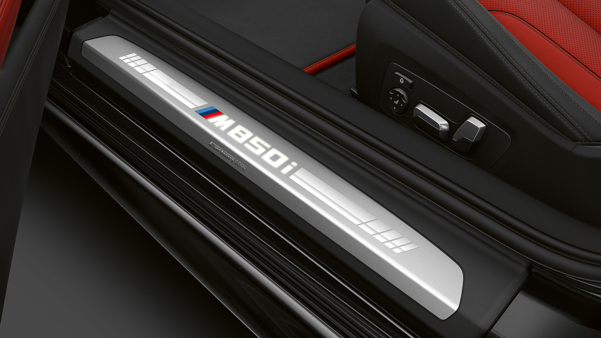 BMW M850i xDrive, Carbon Black metallic, entry door sill.