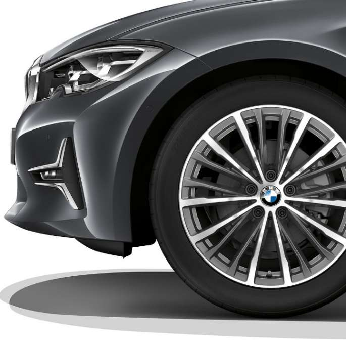 Close-up of the light alloy wheel of the BMW 3 Series Sedan with Model Luxury Line equipment.